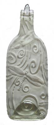 clear, flattened bottle with design