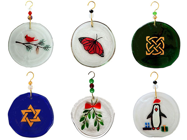6 ornaments made from the bottom of upcycled wine bottles, with various painted designs